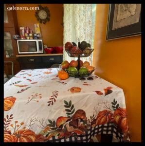 kitchen table wit pumpkin/autumn tablecloth